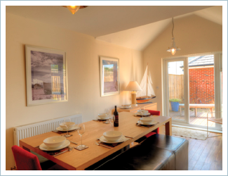 Dining Room of The Light House Pet Friendly Holiday Cottage Camber Sands