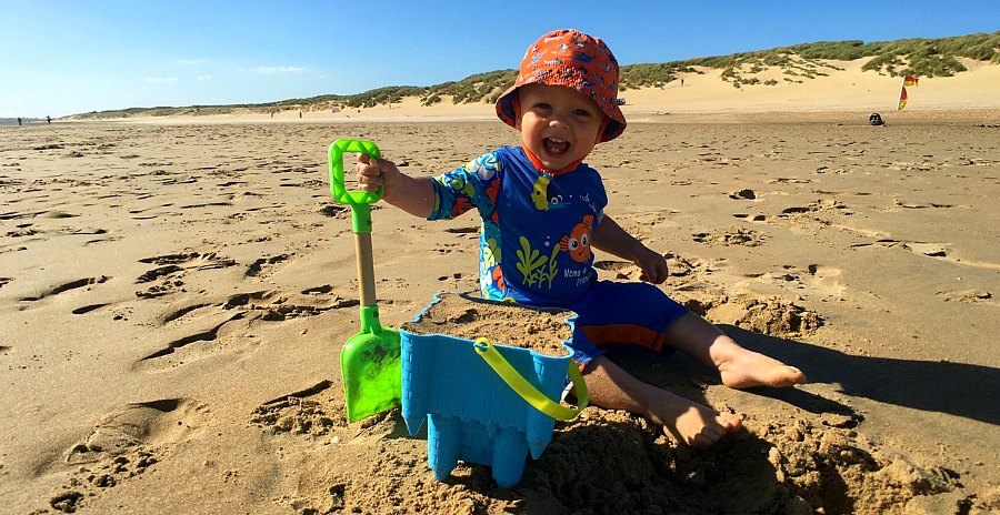 toddler building sandcastle Camber Sands