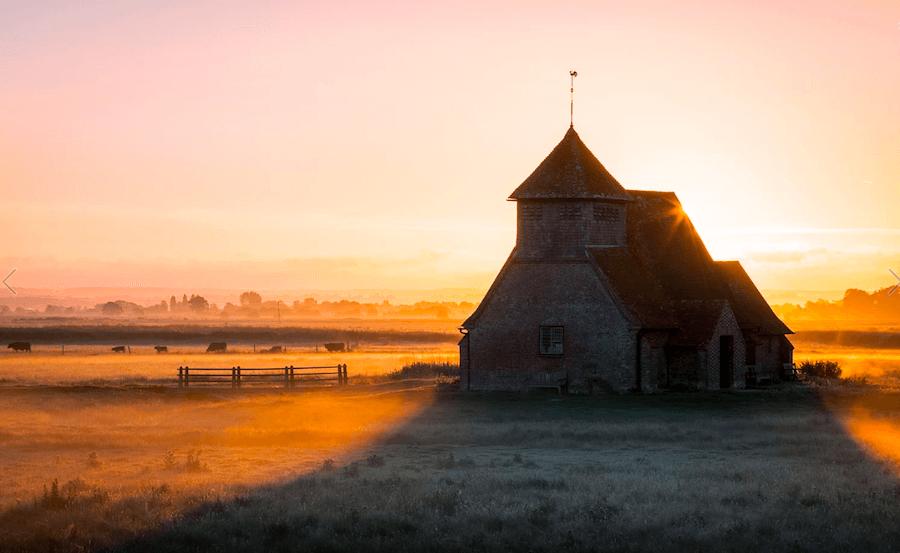 autumn misty sun rise over church