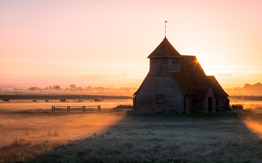 Church on Romney Marsh surrounded by water
