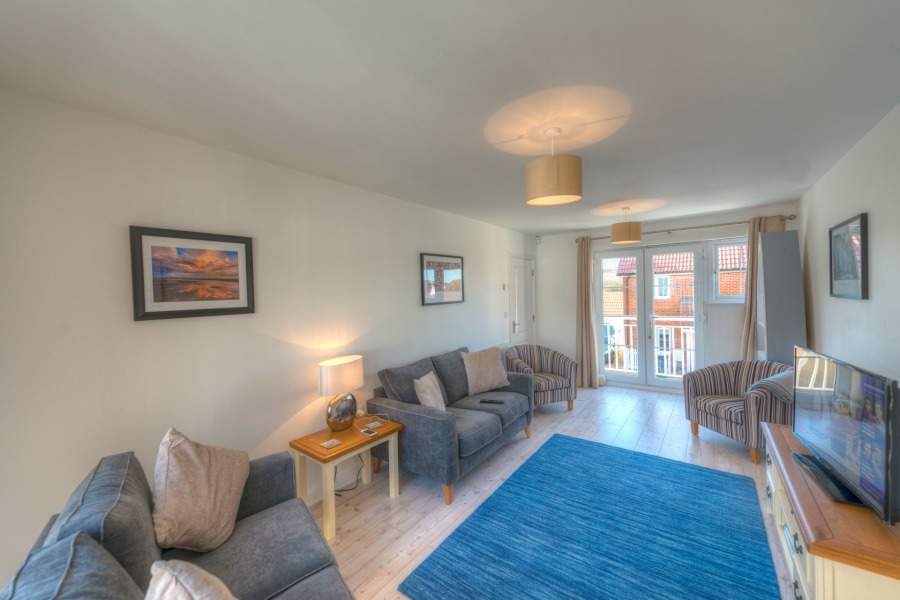 living room blue rug