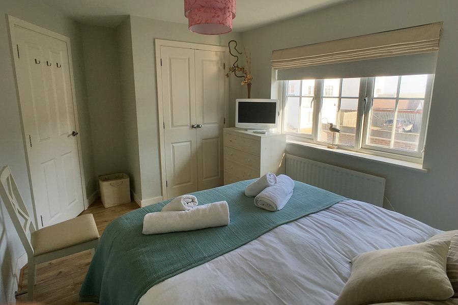 Beachcomber master bedroom with tv