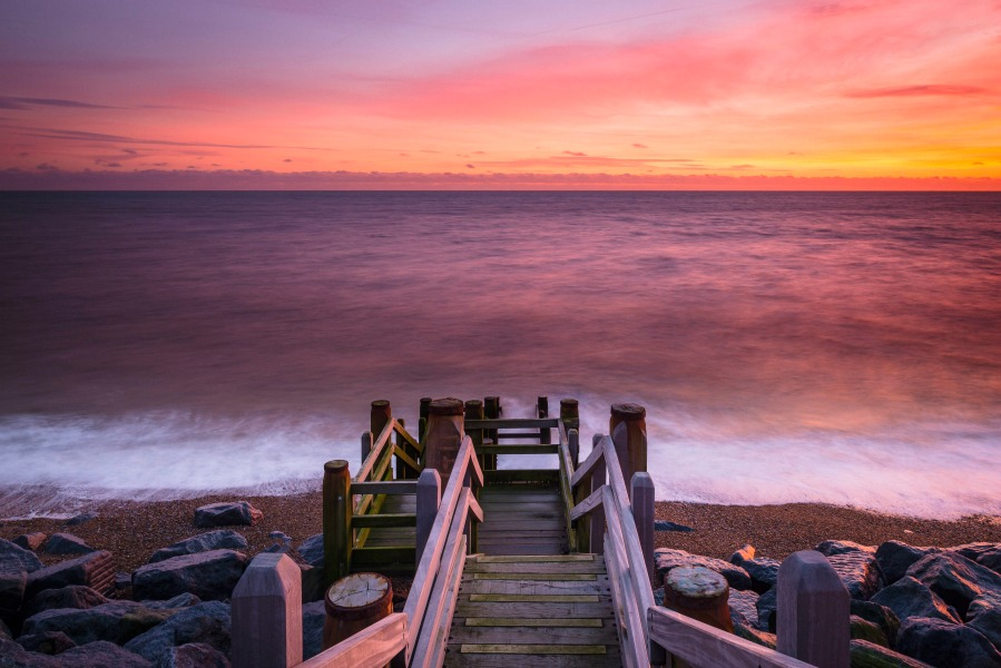 sunset over beach steps at Coastguards Cottages Camber
