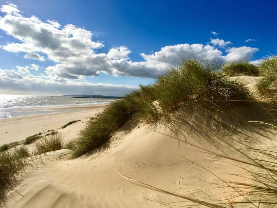 Picnicking among the dunes is one thing to do in Camber Sands