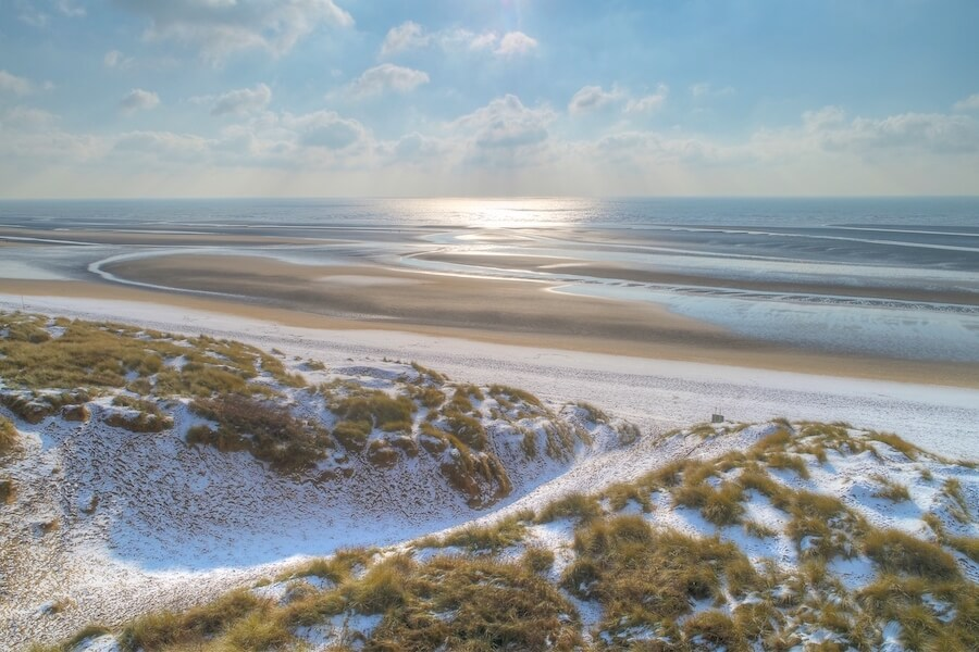 snow covered beach at camber sands