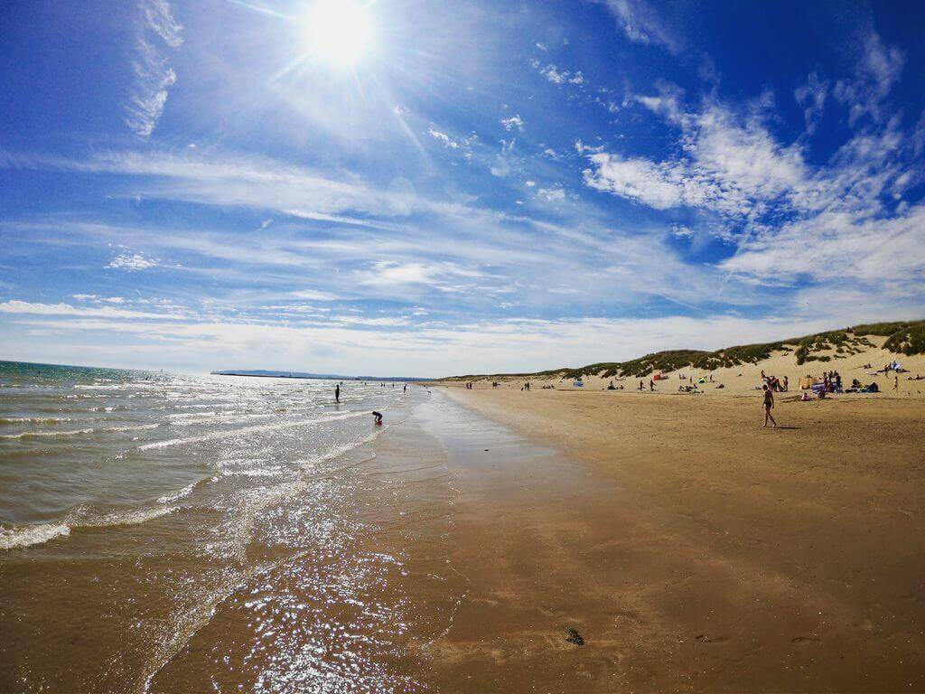 Sun and surf on the beach in Camber Sands in springtime