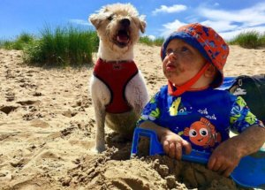 Dog and baby in Camber Sands